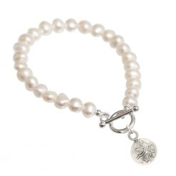 cream pearl bracelet with silver charm