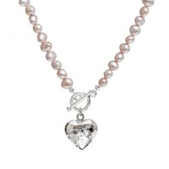 pink pearl necklace with beaten silver heart