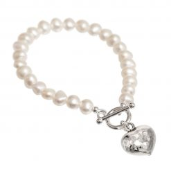 cream pearl bracelet with beaten silver heart